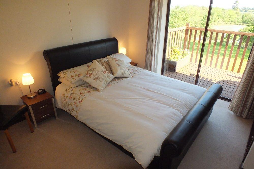 Blagdon Farm - Kestrel Main Bedroom with view of fishing lake